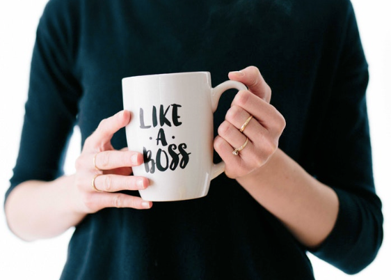 woman holding a cup which says Like a Boss