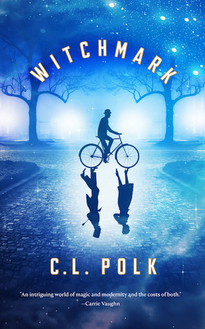 In a park blued out by dusk, a man in a bowler hat rides a bicycle. His reflection on the pavement shows two people, a man and a woman.