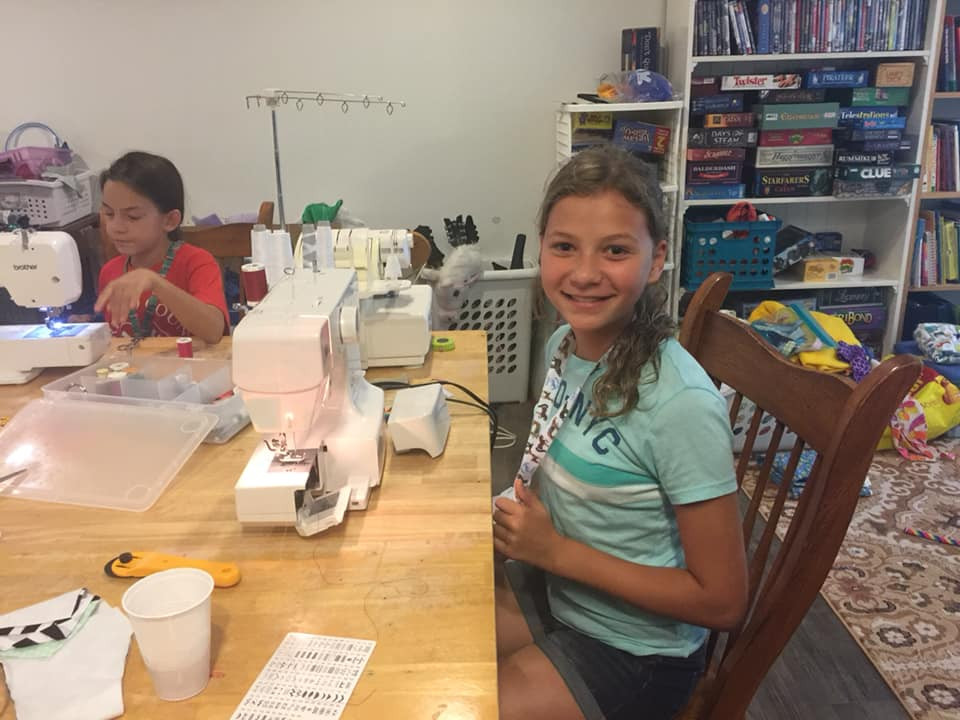 kids working on a 4-h sewing project while earning credit for homeschool classes