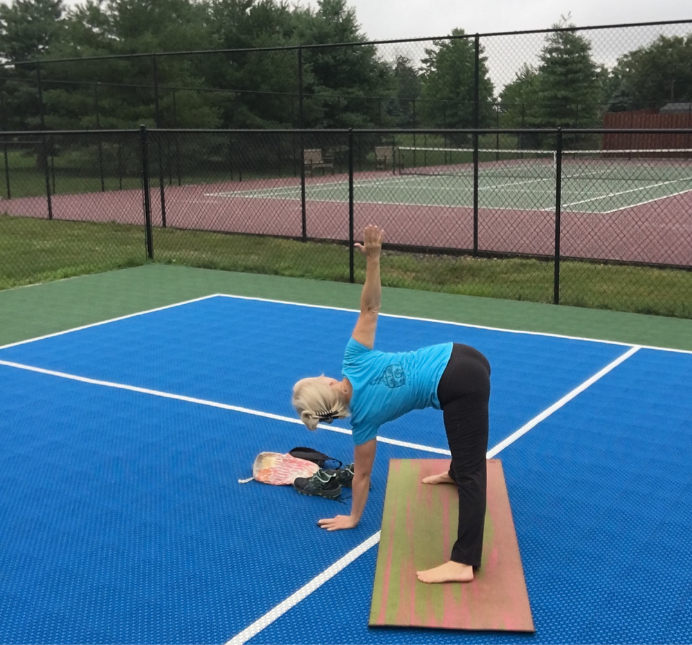 Outdoor Yoga - Tennis, pickleball and Basketball courts are great places to practice Yoga outside.