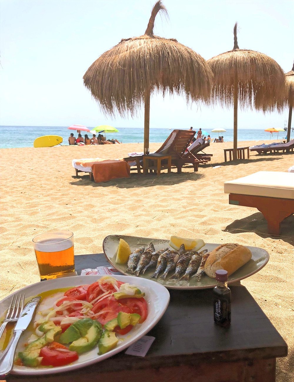 sardine skewers and avocado salad on the beach at Trocadero restaurant