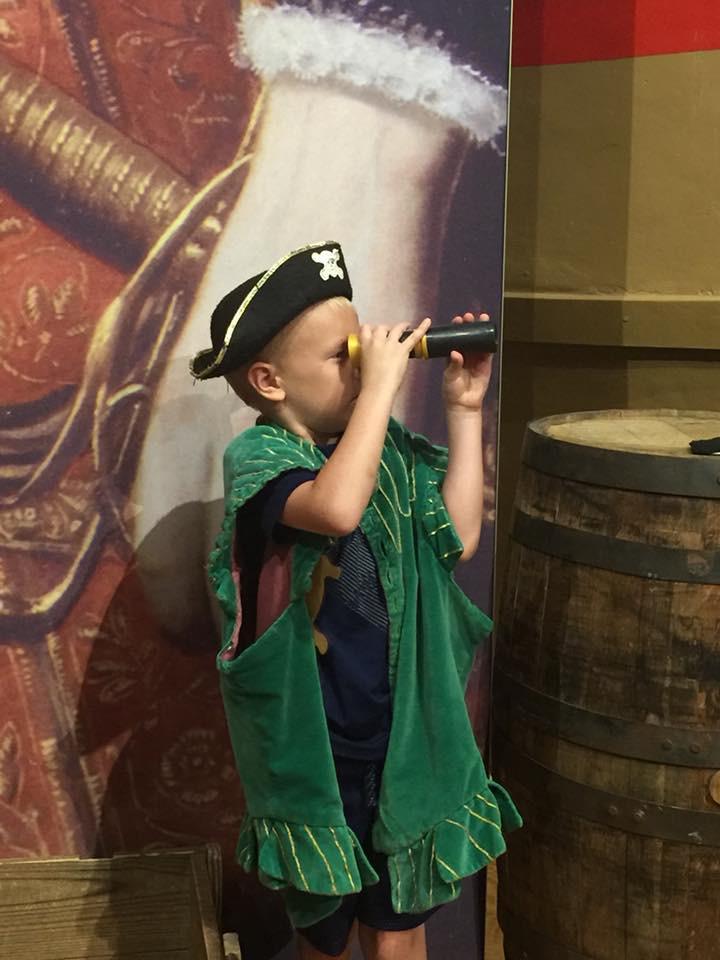kid playing as pirate