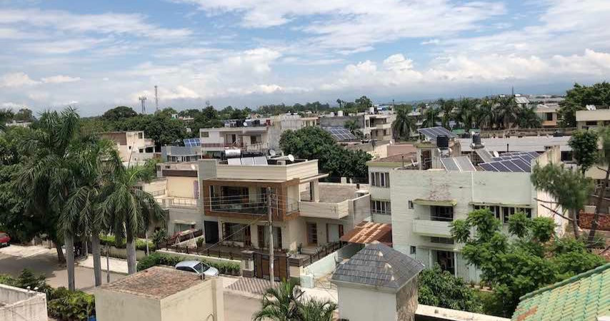 View of Chandigarh rooftops with solar plants on multiple roofs