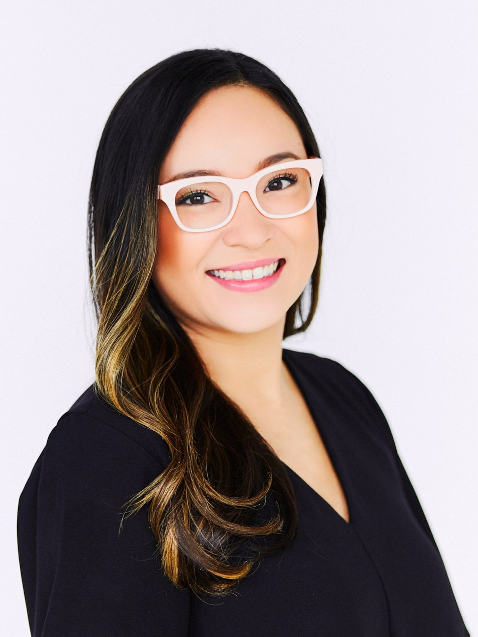 headshot Evy Camacho woman with glasses smiling