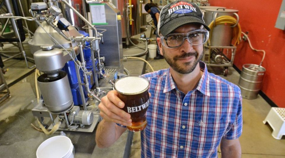 Beltway Brewing owner, Sten Sellier, holds a glass of beer