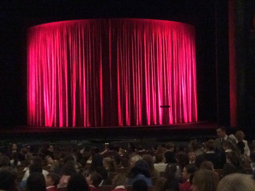 Curtains closed in theatre before performance