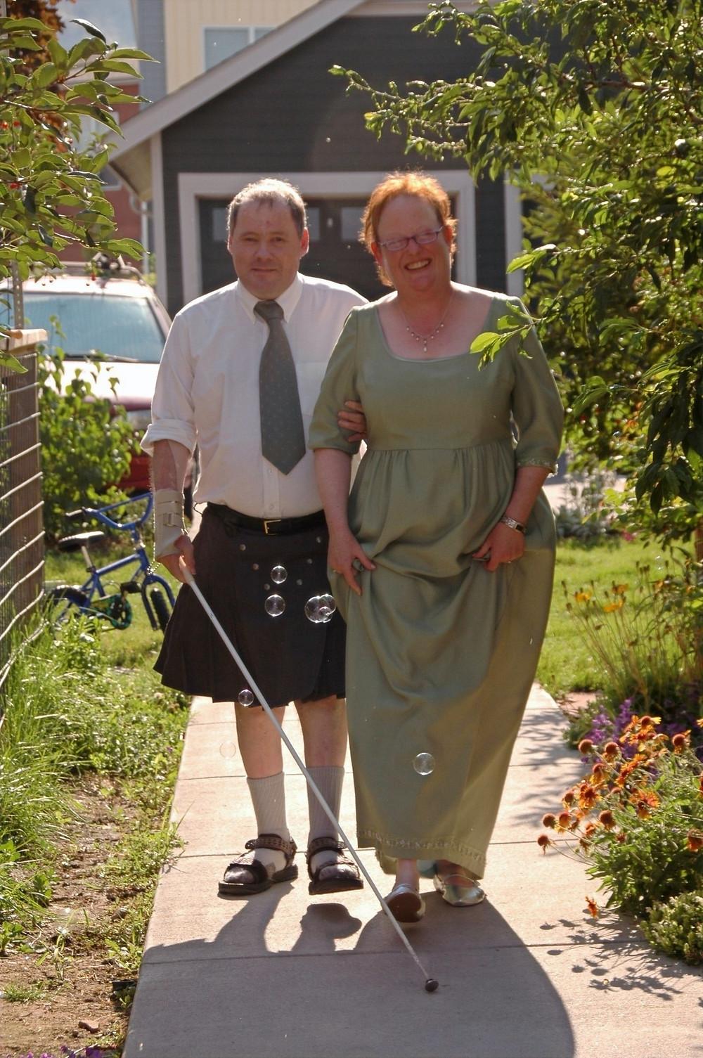 Linda Tate and Jim Rebman walk down the aisle