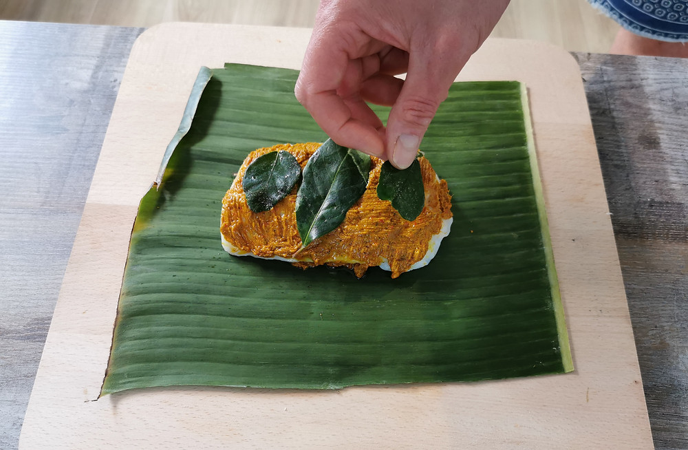 Cod, bumbu spice paste, salam leaf, kaffir lime leaf in banana leaf for Indonesian Ikan Pepesan