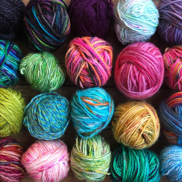 A collection of 20 different yarns all in a variety of colors