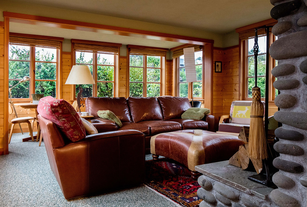 living room, furniture grouping, two furniture groupings, fireplace, beach house, cabin, architecture, budget, living room renovation, wood paneled walls, leather furniture, leather couch, red leather