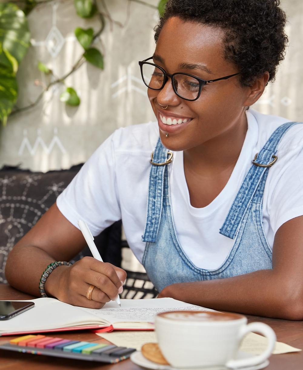 Teenage girl making notes at home: The Parents' Guide to