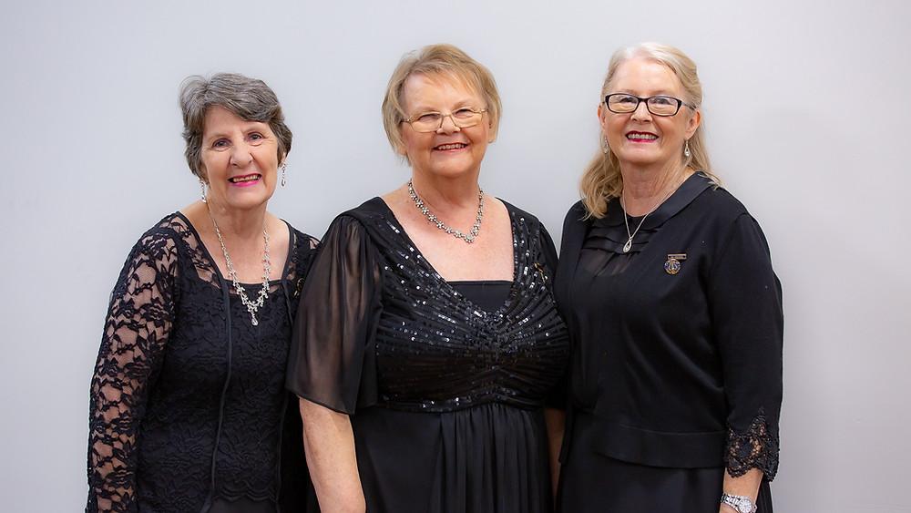 Cheryl Smith, Julie Dell and Cheryl Elliott in formal Choir attire