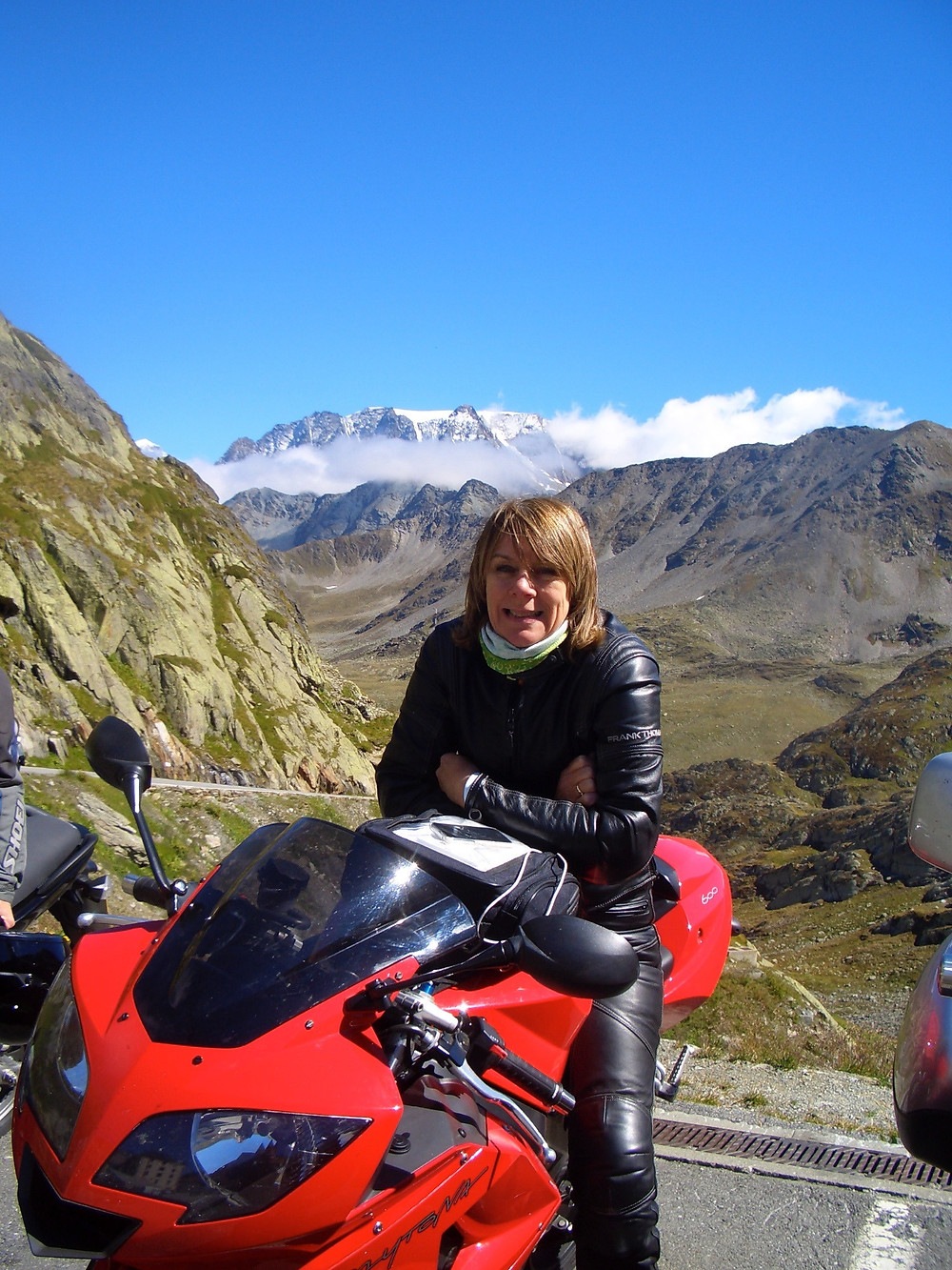 Yoga Teacher Yogawithvickib touring the Alps on her Triumph Daytona motorbike