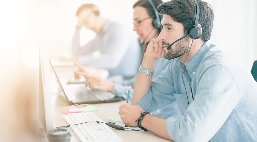 Call center employees call insurance customers to set appointments for customer insurance reviews.