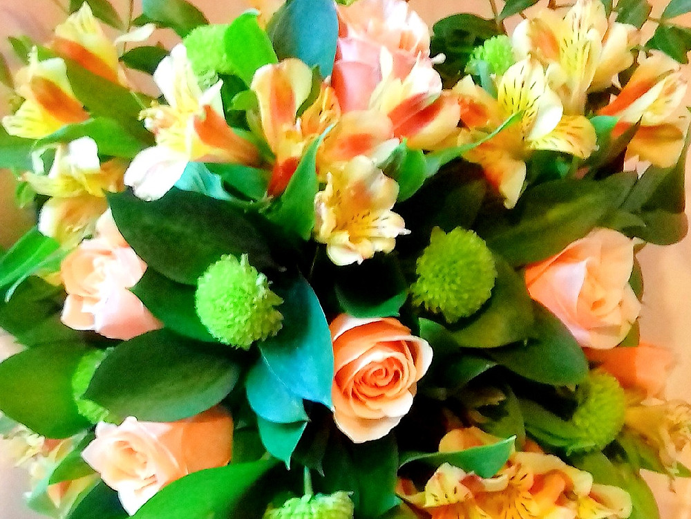 Coral flowers brides bouquet by PC Creations Leeds