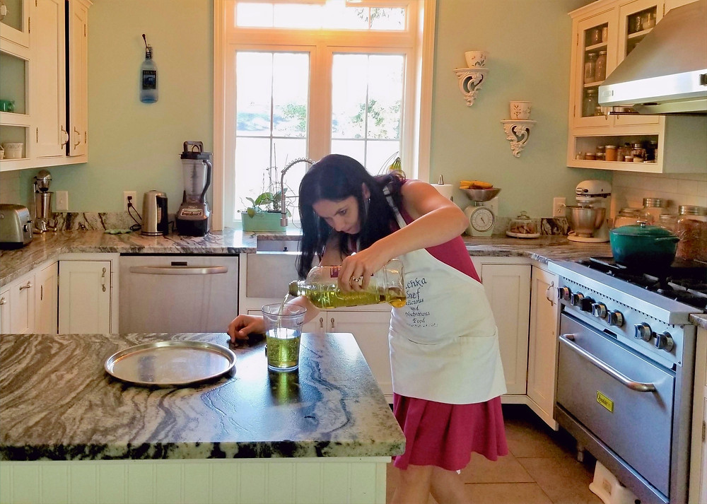 Woman (Inna) measuring oil in the kitchen