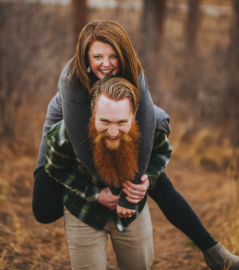 A man gives a woman a piggy back ride