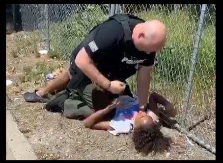 California Cop pins unarmed black boy on the ground, punches him repeatedly in the chest