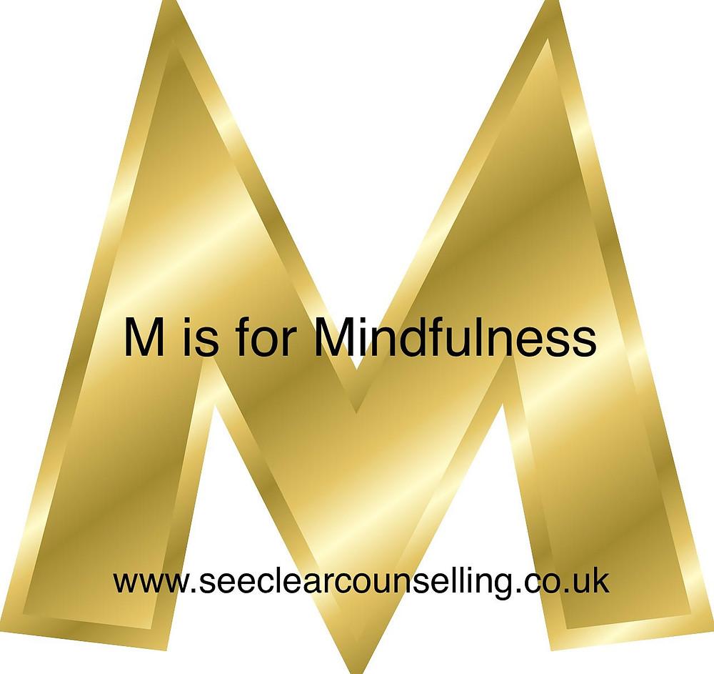 Gold Letter M for Mindfulness