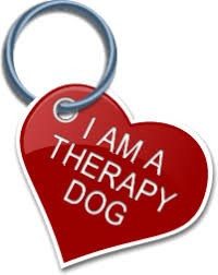 "a heart shaped dog tag that reads ""I a a Therapy Dog"""