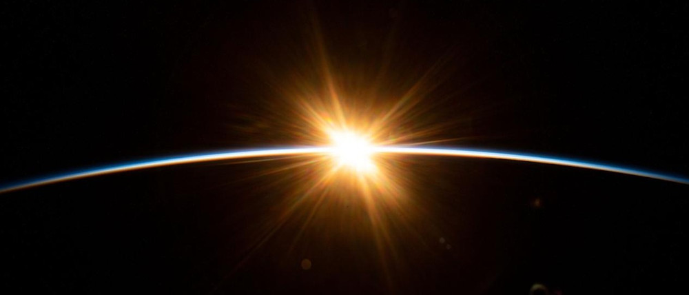 sunrise over earth seen from International Space Station
