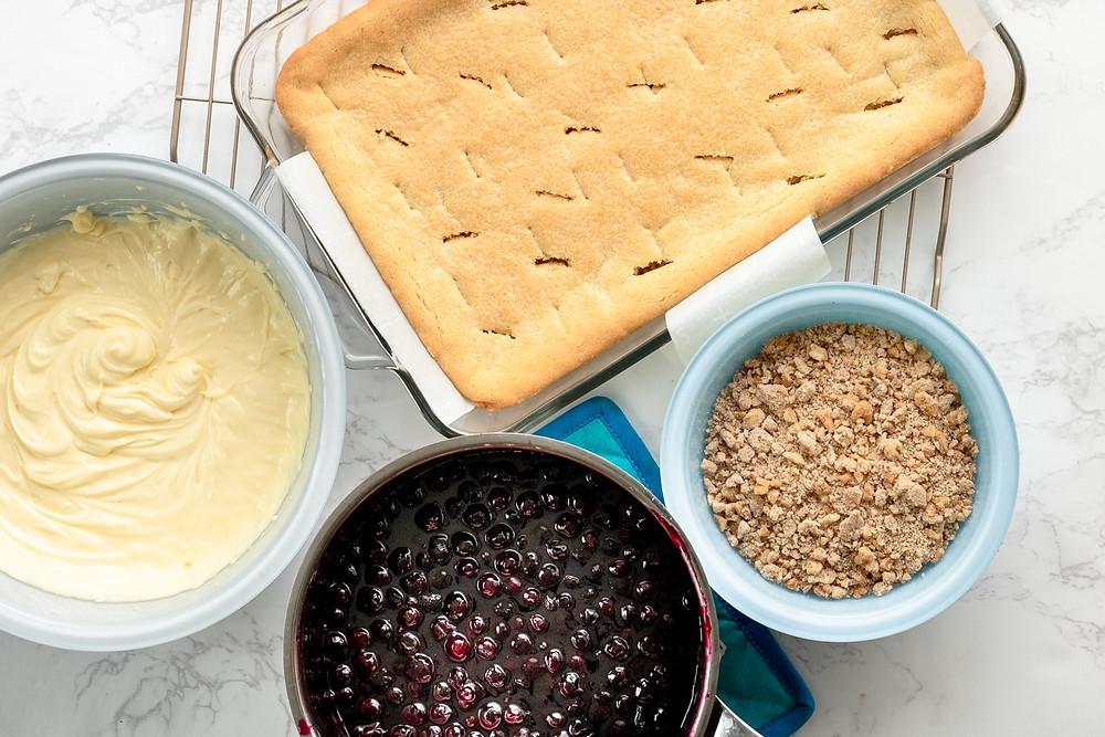 Sugar Cookie Cheesecake Blueberry Crumble Bars