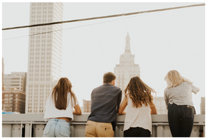 People looking over a city