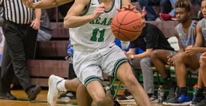 Trojans outpace Greenwaves