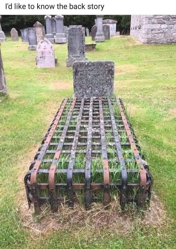 Caged in Grave Site