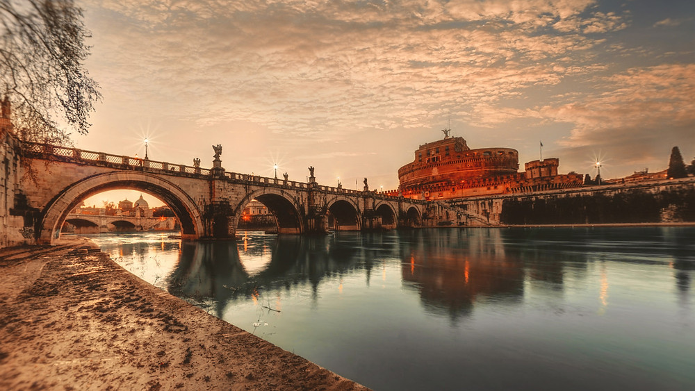 Rome's Castel Sant'Angelo perched on the river in Italy