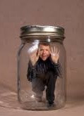 Man in mason jar feeling stuck, trapped, with no way out.