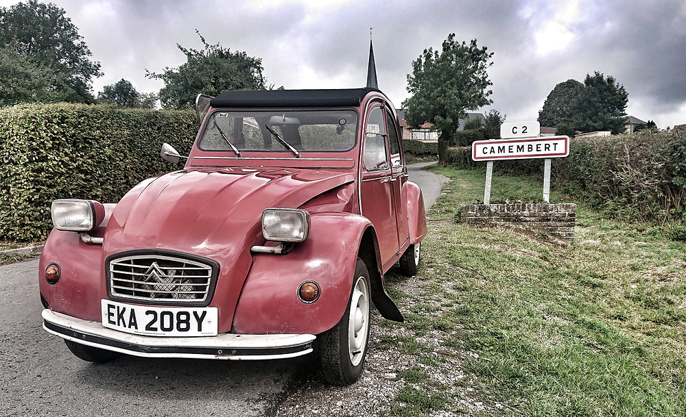Citroen 2CV, red, in Camembert, France.