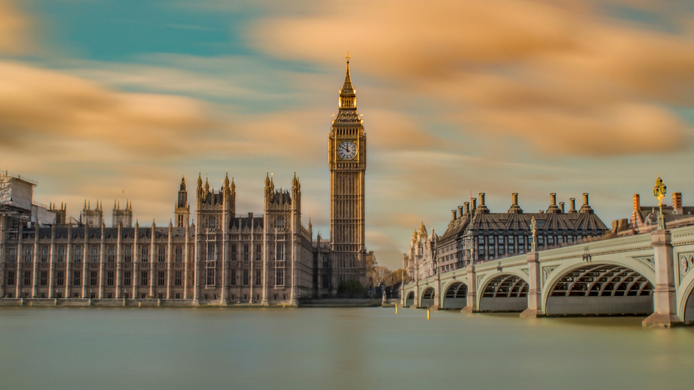 Long exposure capture of the Elizabeth Tower and the British Houses of Parliament on the Thames in London, England
