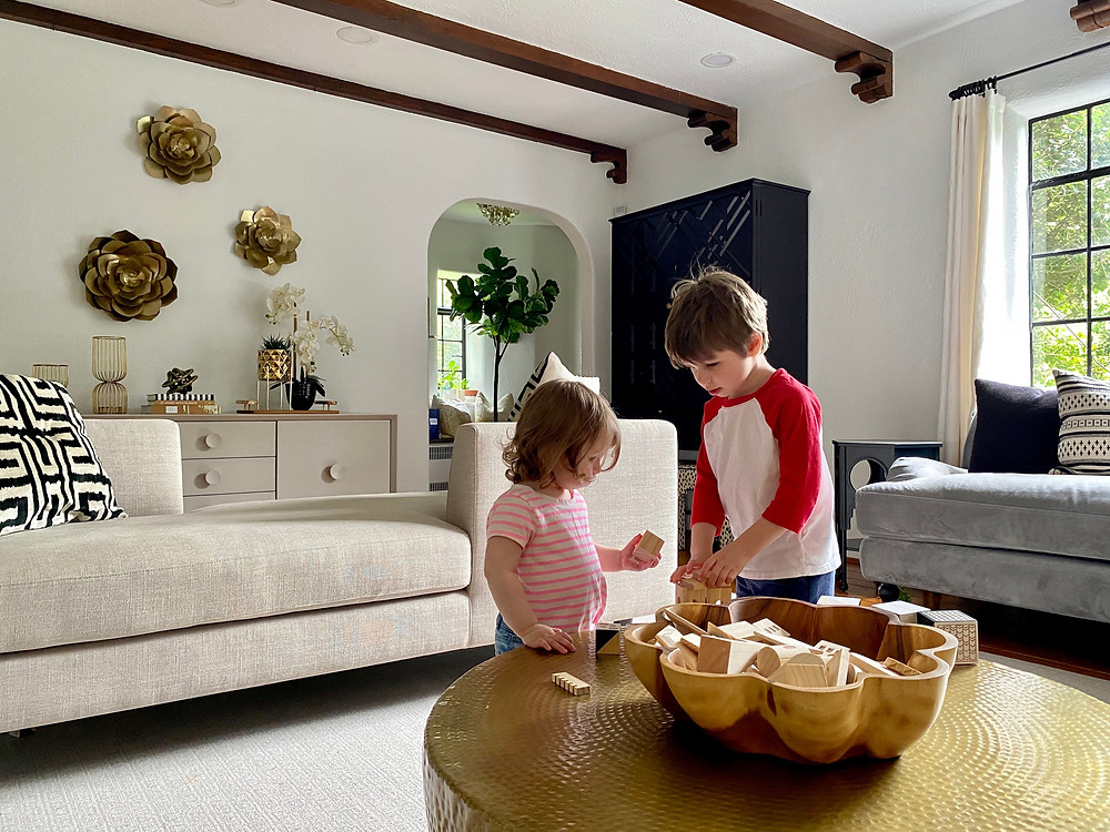 Rye Modern Tudor Design in Westchester: family friendly living room with kids playing at coffee table