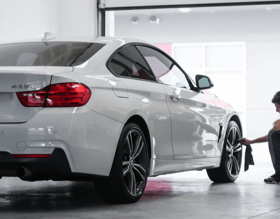 Professional Detailing Tires on a White BMW