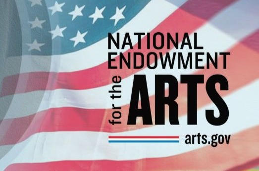 Billowing American flag in background with National Endowment for the Arts, Arts.gov written across it.