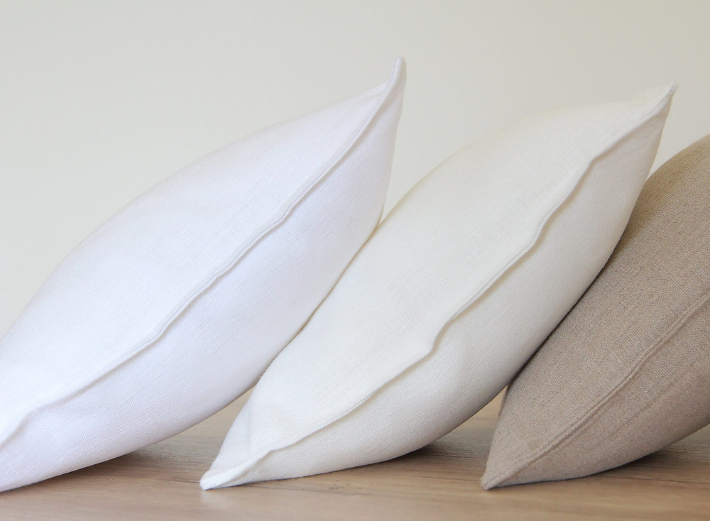 A set of white linen pillowcases