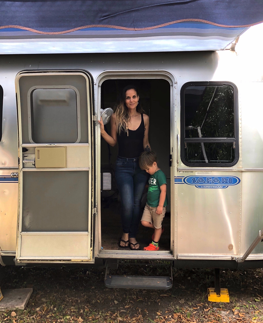 mother and child in airstream rv travel trailer during airstream renovation