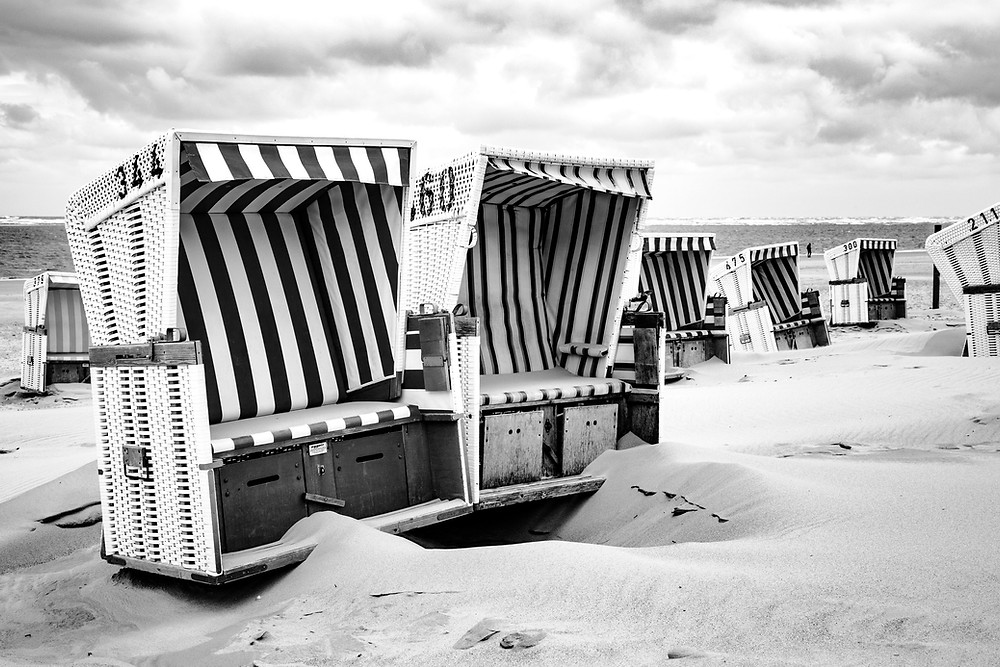 Empty beach with stormy skies