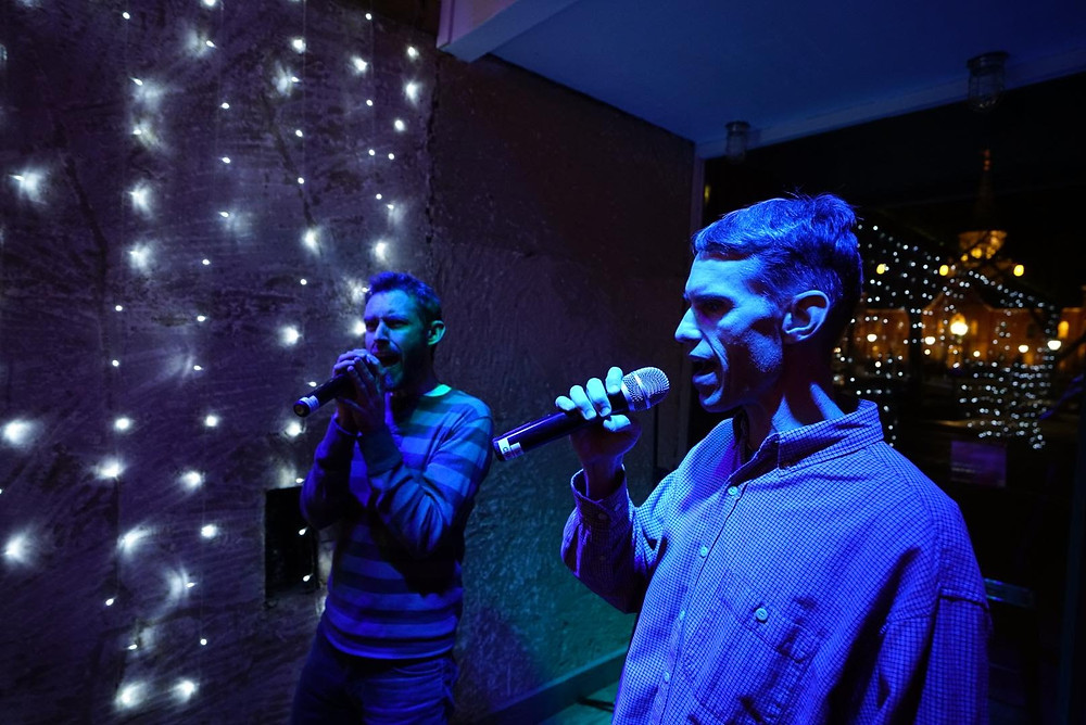 Two men singing Open Mic Karaoke