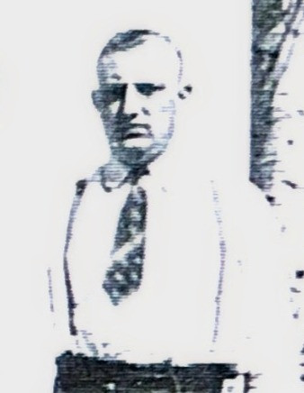 Man in shirt with suspenders and short tie