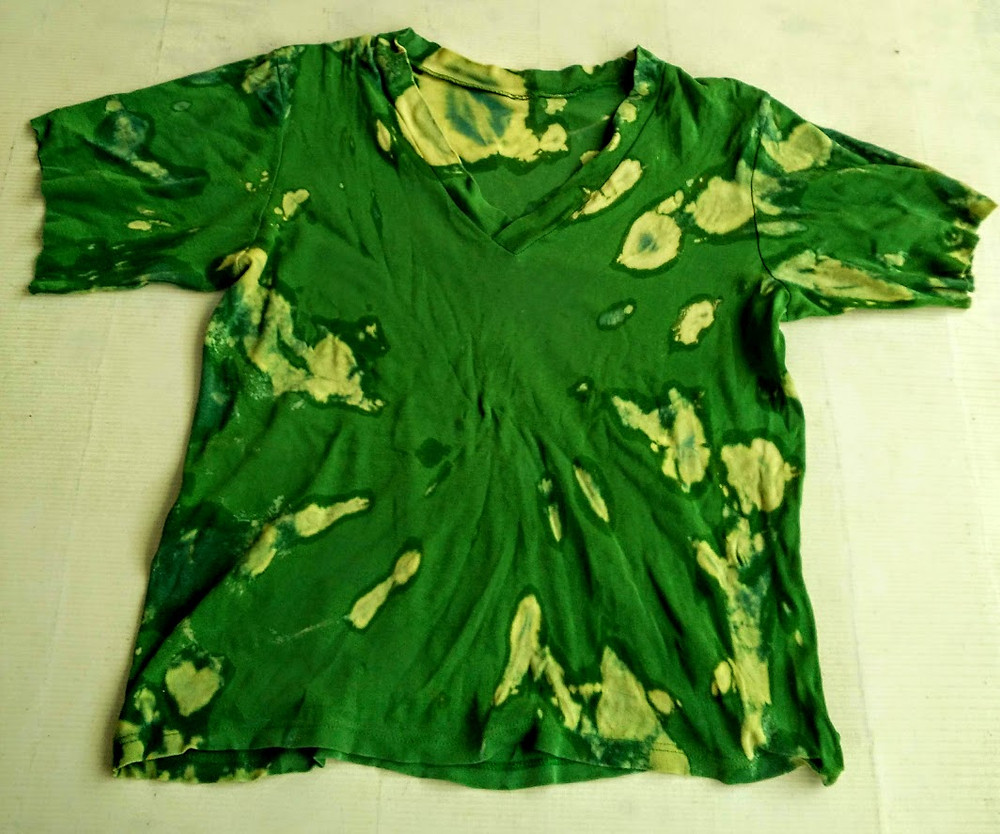 Green t shirt with splatters