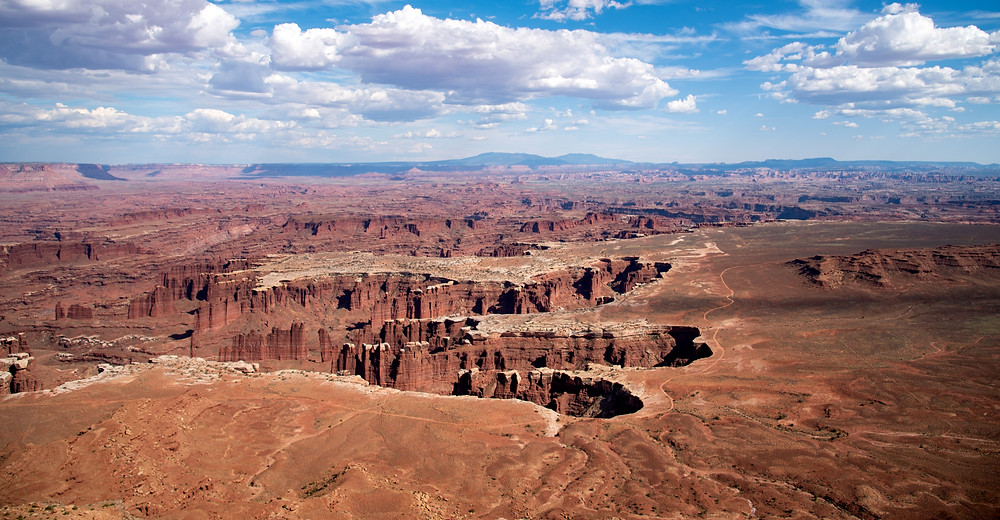 [Image description] A wide angle view of canyonlands national park, with canyons as far as the eye can see