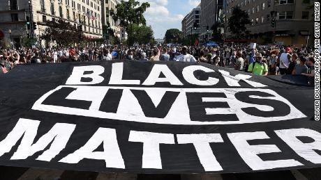 Black Lives Matter flag being carried at Black Lives Matter protest.