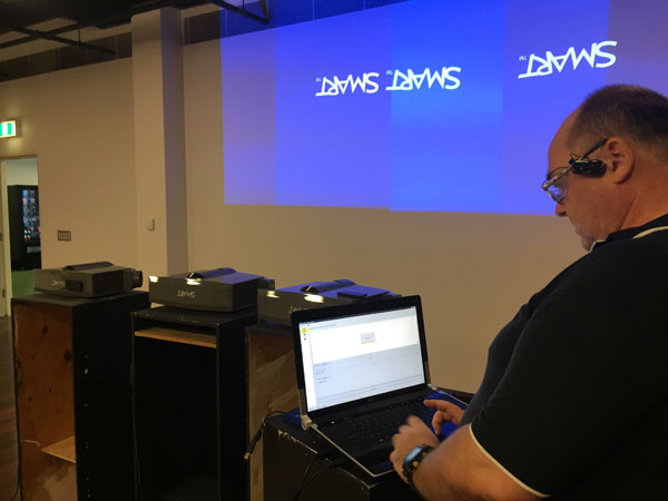 Glenn trying to get the first set of projectors working.