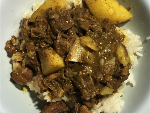 Caribbean style slow cooker goat and potatoes