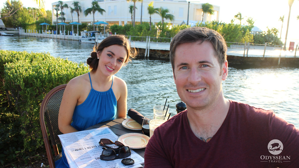 Young couple dining at water's edge in Florida Keys