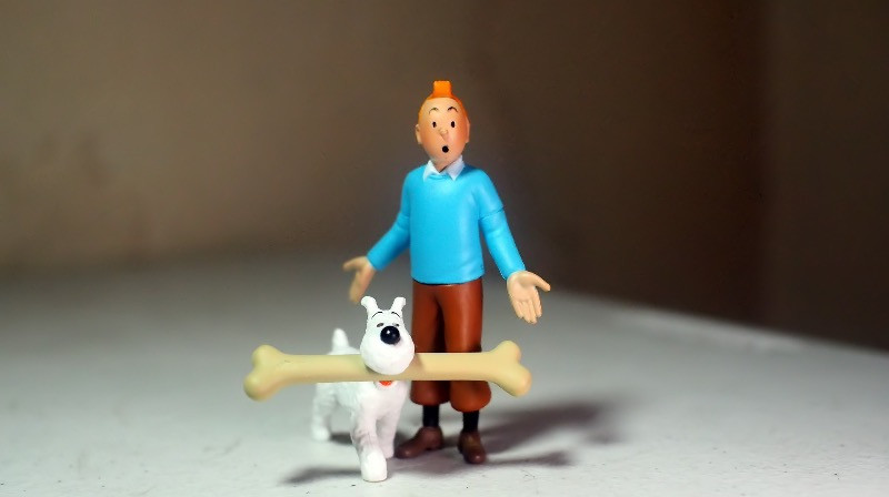 Tintin and Snowy with a dog bone