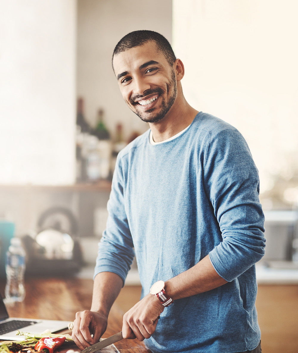 Man chopping butternut squash