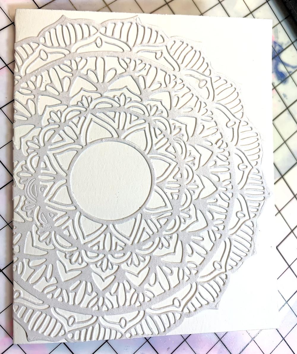 Image is of a mandala diecut adhered to white cardbase